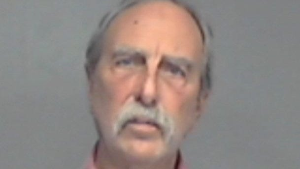 A mug shot of Malcolm when he was arrested on March 9, 2013.