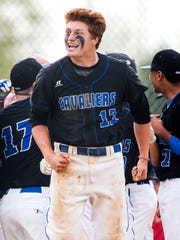 Middletown's Colin Peluse celebrates after teammate Spencer Harbert hit a grand slam during Middletown's 7-1 win over Appoquinimink.