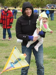 The youngest kite flyer at 9 months old, Lily June Farhi, and her mother, Adeline, from West Chester, Pa., fly a kite as the annual Great Delaware Kite Festival was held on a chilly, cloudy, Good Friday at Cape Henlopen State Park near Lewes.