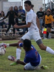 Alamogordo's Julian Torres tries to score on Las Cruces