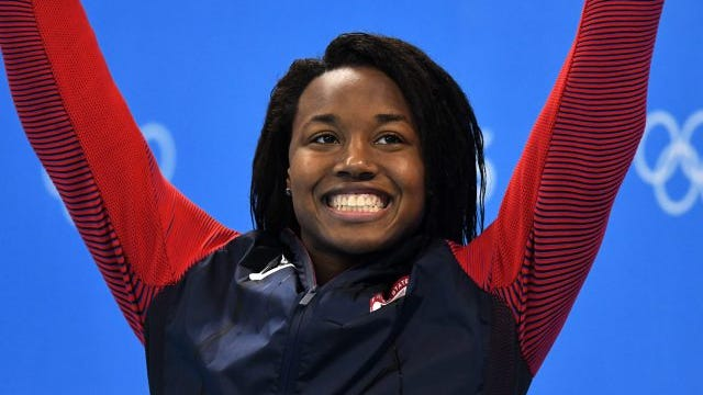 Silver medalist Simone Manuel smiles on the podium during the medal ceremony for the women's 50m freestyle final race of the Rio 2016 Olympic Games Swimming events at Olympic Aquatics Stadium at the Olympic Park in Rio de Janeiro, Brazil, 13 August 2016.
