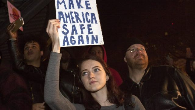 Protesters gather at Rosa Parks Circle in Grand Rapids, Mich.,  Thursday, Nov. 10, 2016, in opposition of Donald Trump's presidential election victory.