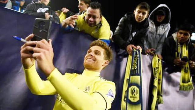 Nashville SC forward Alan Winn (19) takes a selfie with fans after the 2-1 loss to Atlanta United at Nissan Stadium in Nashville on Feb. 29.