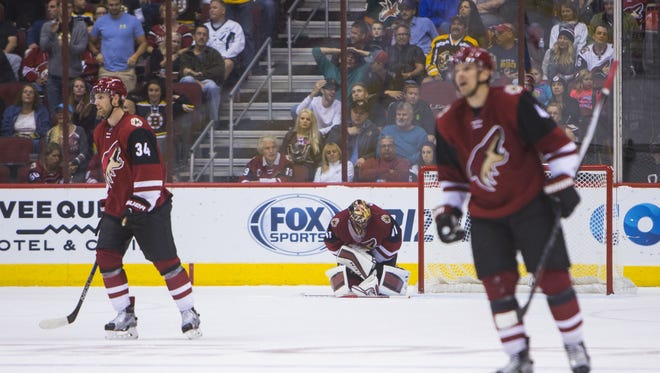 Coyotes' Mike Smith (41), Klas Dahlbeck (34) and Zbynek Michalek (4) react after allowing the second goal in the second period at Gila River Arena in Glendale, AZ  on October 17, 2015.