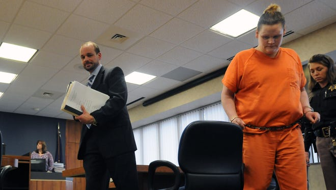 Elizabeth Long exits the courtroom Monday, Feb. 8, during a hearing in Judge West's courtroom.