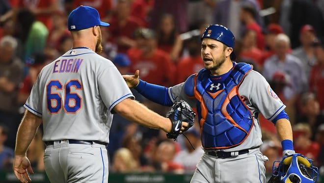 Mets relief pitcher Josh Edgin (66) is congratulated by catcher Travis d'Arnaud (18) after earning a save against the Washington Nationals at Nationals Park.