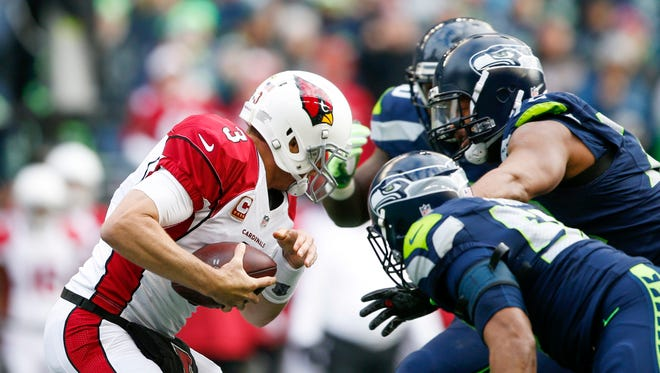 Dec 24, 2016: Seattle Seahawks defensive end Michael Bennett (72) sacks Arizona Cardinals quarterback Carson Palmer (3) during the first quarter at CenturyLink Field.