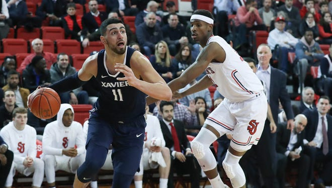 Xavier Musketeers forward Kerem Kanter (11) drives past St. John's Red Storm forward Tariq Owens (11) during the first half at Carnesecca Arena.
