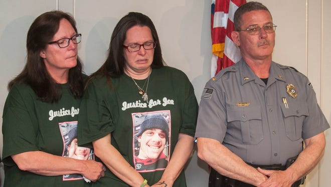 Megan Pirri, center, wife of Joseph Pirri, sheds tears as she stands with her mother Betty Jean Hampton, left, and Deptford Police Chief William Hanstein, right, during a press conference held at the Gloucester County Prosecutor's Office in Woodbury on Wednesday, April 25, 2018 to announce the arrest of Everett E. Moore Jr. of Clayton, charged with murder for the alleged slashing that killed Joseph Pirri during a road rage incident in Deptford last month.