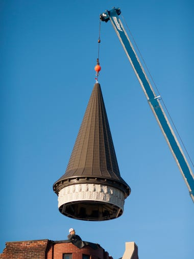 "The ""witch's hat"" steeple was hoisted up by a crane"
