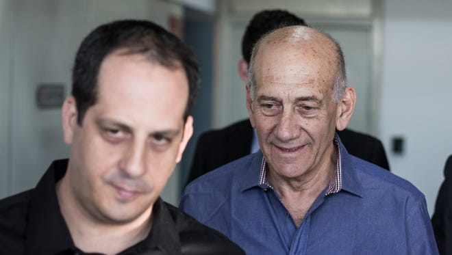 Former Israel Prime Minister Ehud Olmert, right, on March 31.