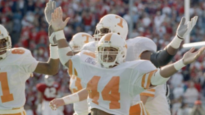 Vols running back Chuck Webb (44) raises his arms after scoring a 79-yard touchdown in the third quarter of the Cotton Bowl against the Arkansas Razorbacks on Jan. 2, 1990, in Dallas. Webb was the offensive player of the game. Tennessee won 31-27.
