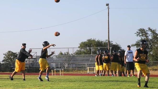 Yfat Yossifor / Standard-Times Menard High School football players participate in their first practice of 2016 on Monday.