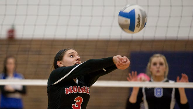 Cardinal Mooney senior Angie Kuczewski bumps the ball during a Class D volleyball quarterfinal Tuesday at Lapeer High School.