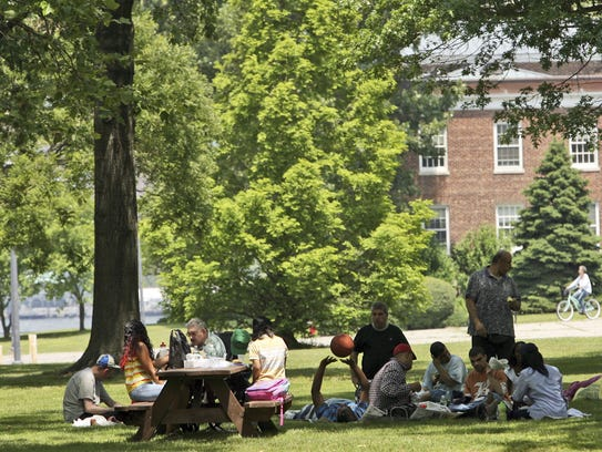 Visitors enjoy a picnic in the shade of one of the