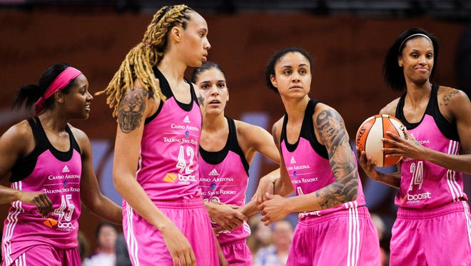 Phoenix Mercury players stand seconds before defeating the Minnesota Lynx 73-66 at the U.S. Airways Center in Phoenix, AZ, on Friday, August 7, 2015.