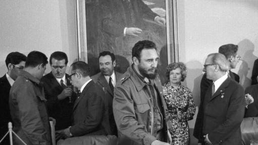 FILE - In this June 1972 file photo, Cuba's leader Fidel Castro, center, attends the signing of a bilateral agreement between the German Democratic Republic and Cuba. Castro has died at age 90. President Raul Castro said on state television that his older brother died late Friday, Nov. 25, 2016.