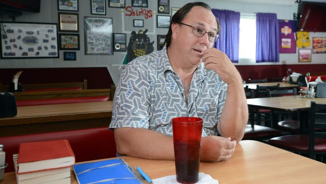 """John Kestner talks about his novels """"Yesterday Rules"""" and """"Vegas Working Girl"""" and his career as a writer Thursday, May 17, 2018, at Shirky's Pizza in Carroll. Kesnter grew up in Carroll and says """"Yesterday Rules"""" is a mostly true memoir of that time. He worked at Shirky's, then called Pizza Cottage, while a student at Bloom-Carroll High School."""