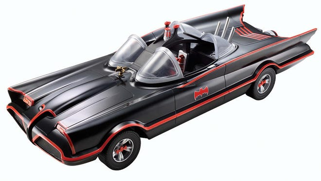 This week's giveaway prizes include Adam West's Batmobile, on sale now from Mattel.