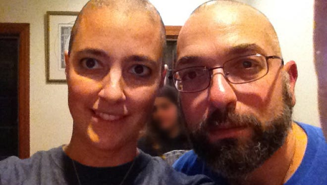 Doctors Amy Reed and Hooman Noorchashm after the start of Reed's chemotherapy treatment. Reed, a Boston doctor, had what she thought was a routine hysterectomy that actually ended up spreading cancer and making it much worse. She is now campaigning against the procedure she had.