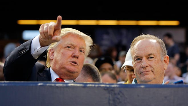 Donald Trump and television personality Bill O'Reilly attend the game between the New York Yankees and the Baltimore Orioles at Yankee Stadium on July 30, 2012  in the Bronx borough of New York City.