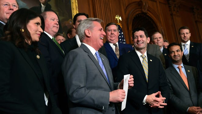 House Majority Leader Kevin McCarthy of Calif., and House Speaker Paul Ryan of Wis., share a laugh as they wait to start a news conference following a vote on tax reform on Capitol Hill in Washington, Thursday, Nov. 16, 2017.