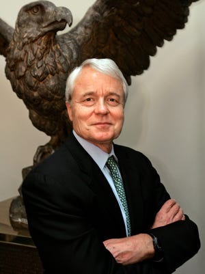 In this July 20, 2005 photo, Los Angeles Times editor John Carroll poses for a portrait at the newspaper's headquarters in downtown Los Angeles. Carroll, former editor of the Baltimore Sun and the L.A. Times, which won 13 Pulitzer Prizes during his five-year tenure, died Sunday morning, June 14, 2015 at his home in Lexington, Ky., said his wife, Lee Carroll.  He was 73.