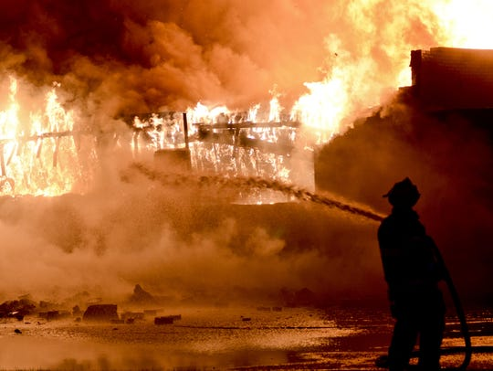 Members of the Port Huron Fire Department battle a large fire in 2013 at the River District Super Market, 3550 Electric Ave. A call came in at 2:17 a.m. when an officer was flagged down by a bystander. The structure was fully involved by the time crews arrived.