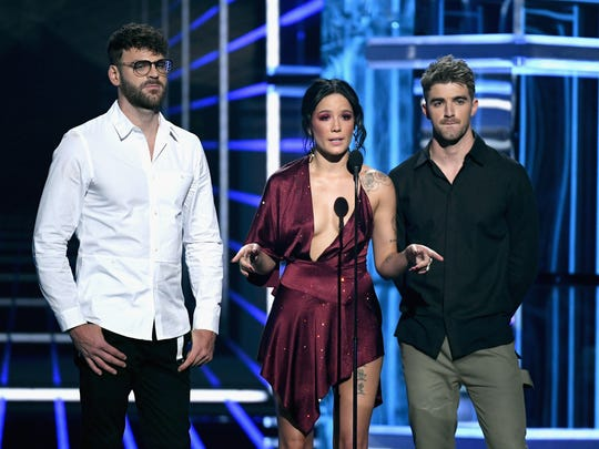 Recording artists Alex Pall, left, and Andrew Taggart of The Chainsmokers and Halsey speak at Sunday's Billboard Music Awards.