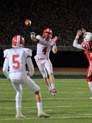 Albany's Brian Hamilton fires a pass to Cameron Dacus