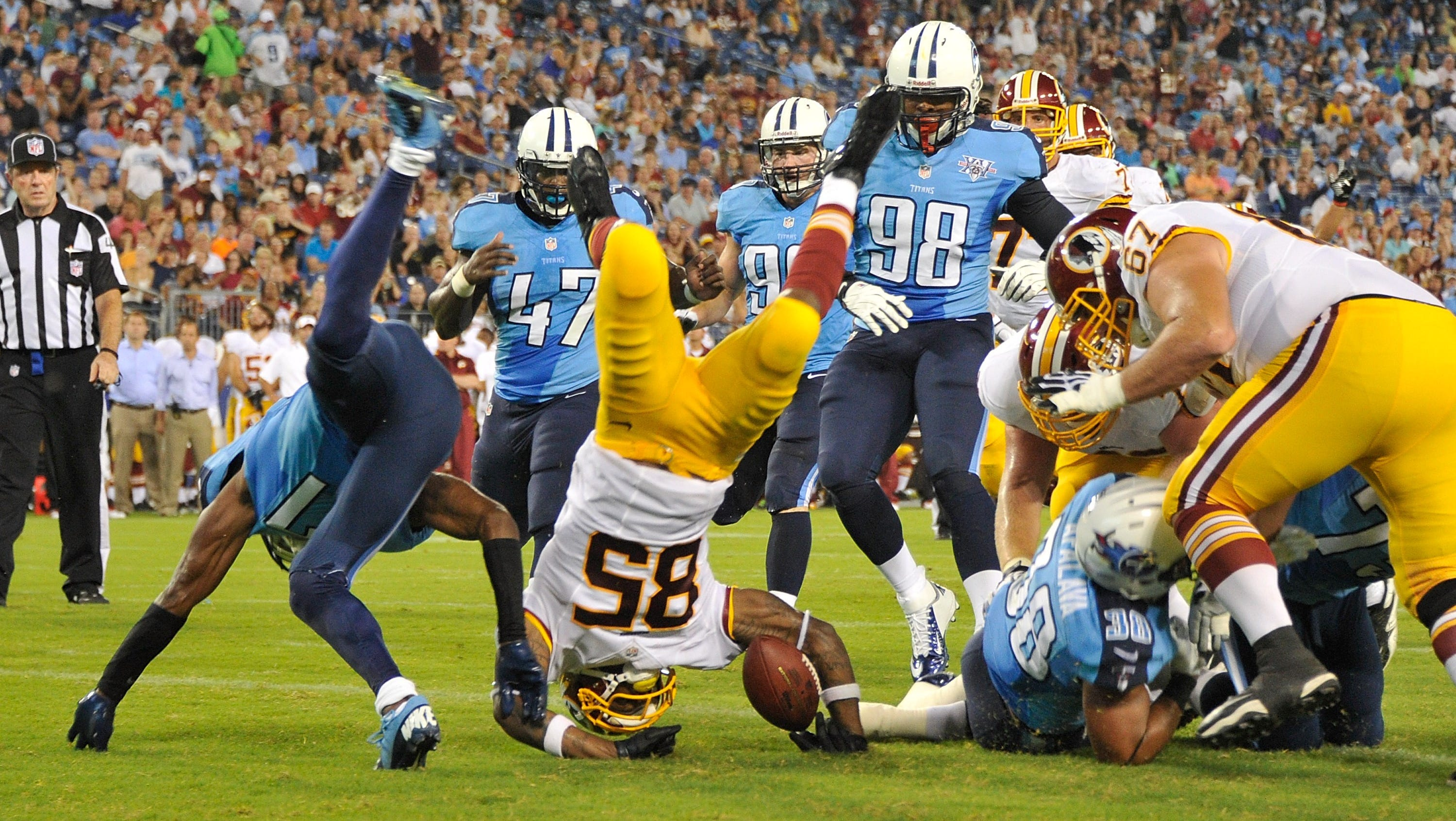 Washington Redskins wide receiver Leonard Hankerson (85) dives into the end zone to score a touchdown against the Tennessee Titans during a preseason game at LP Field.