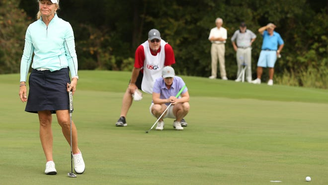 Naples' Mary Jane Hiestand reacts to missing her par putt at the 17th hole as Kelsey Chugg waits to putt during the final round at the 2017 U.S. Women's Mid-Amateur at Champions Golf Club in Houston, Texas on Thursday.