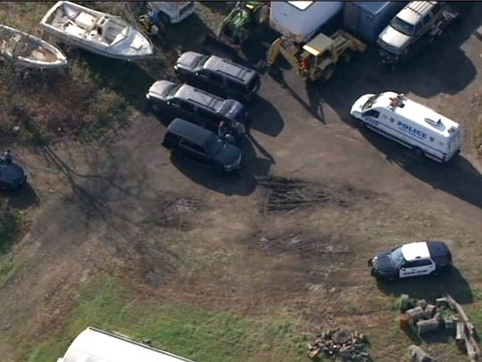 Police gather at the rear of the Foggia Florist and Greenhouses where the body of Joseph Comunale, a 26-year-old Hofstra University graduate originally from Connecticut, was reportedly found Wednesday, November 16, 2016.  IMAGE COURTESY OF WNBC-TV