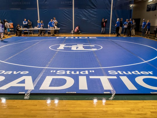 A mat with his name was made for Harper Creek's head varsity wrestling coach Dave Studer for his 50 years of continuous coaching at Harper Creek Wednesday evening.