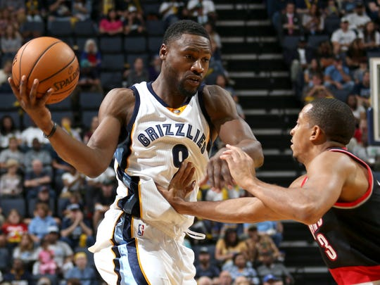 Memphis Grizzlies Tony Allen works against the defense of Portland Trailblazers CJ McCollum.
