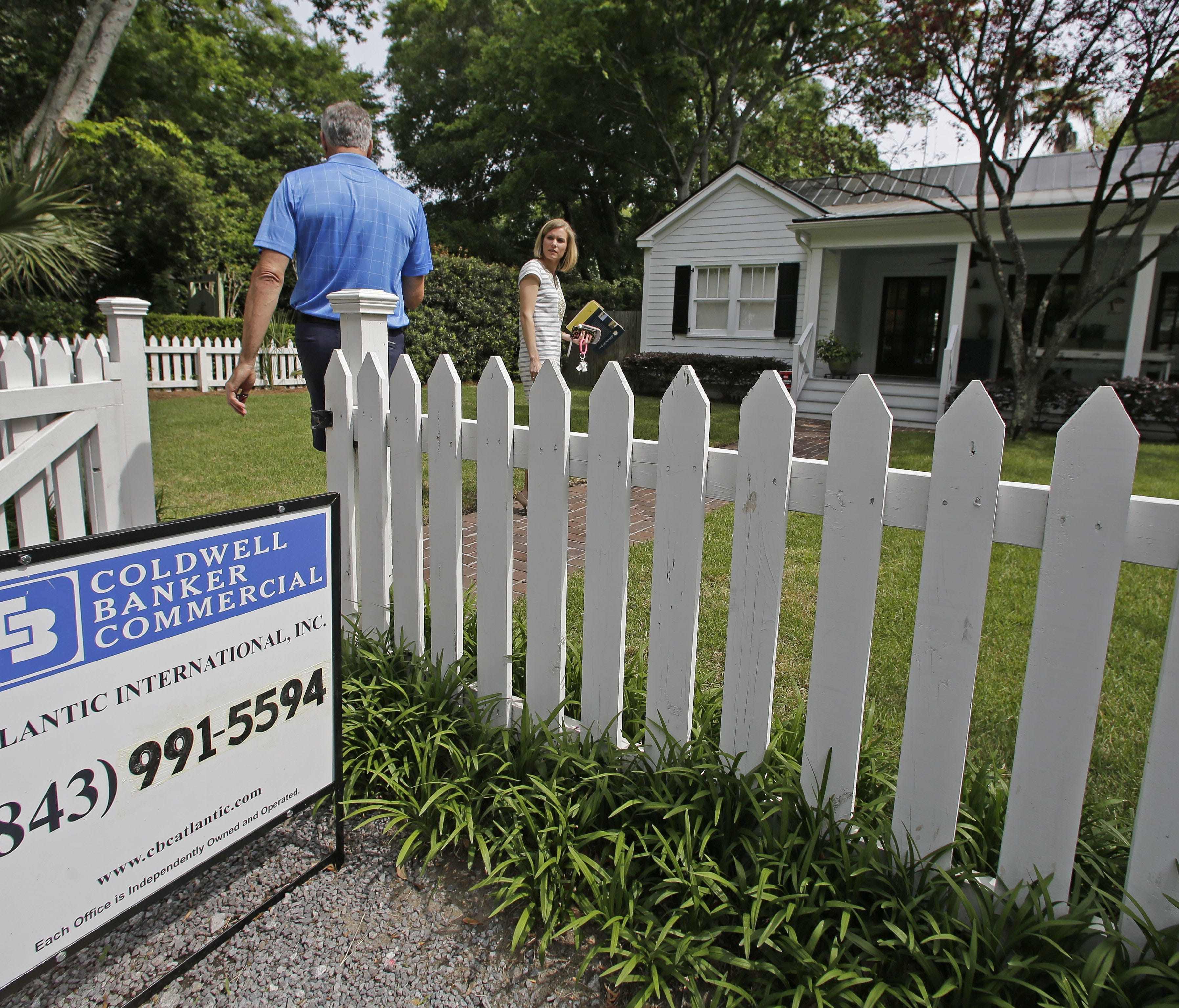A real estate agent prepares to show a client a home for sale in Mount Pleasant, S.C.