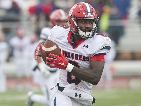 Stepinac's Trill Williams (6) heads for the end zone after catching a first half pass against Canisius during the Catholic State Championship game in West Seneca, New York Nov. 25, 2017. Stepinac won the game 49-28.