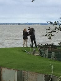 Two C-SPAN journalists capture images of the bay of Green Bay off Van Lanen Road in Green Bay on Sunday. A producer and photographer are in Brown County this week to shoot video for stories about the Green Bay area that are scheduled to air in mid-October.