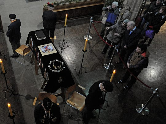 Members of the public view the coffin of Richard III
