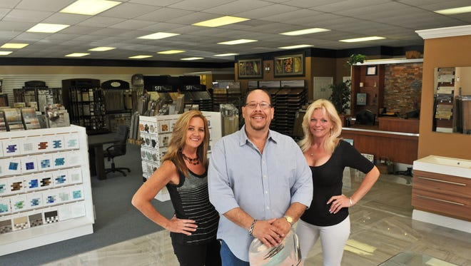 Dina Toppi, vice president, Tony Bastone, president, and Gigi Bocchino, designer, of Florida Flooring & Remodeling, located at 401 N, Wickham Road, in Melbourne,  just south of Dustin's Bar-B-Q.