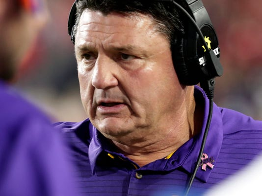 LSU head coach Ed Orgeron expresses worry in the first half of an NCAA college football game against Mississippi in Oxford, Miss., Saturday, Oct. 21, 2017. No. 24 LSU won 40-24. (AP Photo/Rogelio V. Solis)