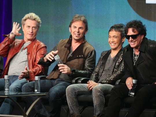 (L-R) Journey band members, bassist Ross Valory, keyboardist Jonathan Cain, lead vocalist Arnel Pineda and guitarist Neal Schon.