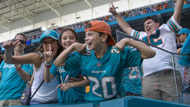 Dolphins fans celebrate a victory over the Jets in 2019.