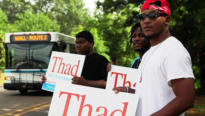 Danny Hobbs, 23, front, Daryl Bourne, 24, and Tony Johnson, 18, back, campaign for six-term incumbent Sen. Thad Cochran, R-Miss., Tuesday, June 24, 2014, near the Rowan School precinct in Hattiesburg, Miss. during the Republican primary runoff election.