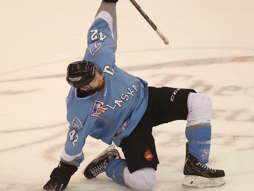 Alaska's Nick Mazzolini celebrates after scoring a goal for the Aces during the Kelly Cup finals.