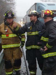 Rescue squad volunteers, from left, Brian Woodard, Hawk Wingate and Kyle Fuqua at a crash scene last fall.