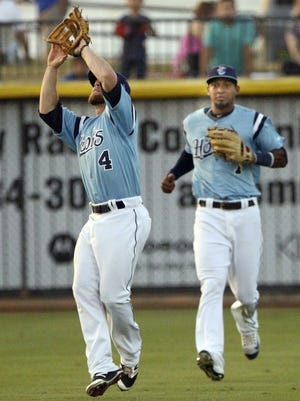 GEORGE TULEY/SPECIAL TO THE CALLER-TIMES Hooks shotstop Nolan Fontana (4) made all three outs in the fourth inning, including this leaping catch while dropping back into shallow left field at Whataburger Field on Friday. Left fielder Danry Vasquez is at right.