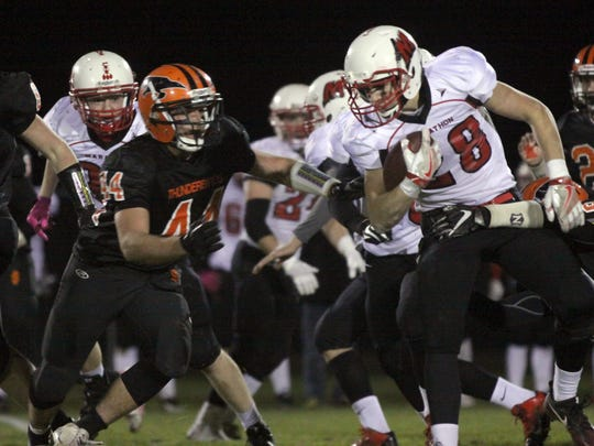 Bryce Mathwich attempts to break a tackle during the Raiders quarterfinal matchup with the Thunderbirds.
