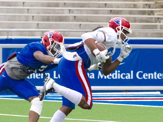 Louisiana Tech wide receiver Kam McKnight, right, hauls