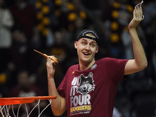 Loyola-Chicago center Carson Shanks cuts the net after a regional final NCAA college basketball tournament game against Kansas State, Saturday, March 24, 2018, in Atlanta. Loyola-Chicago won 78-62. (AP Photo/Mike Stewart)
